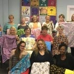 Casa del Sol group donate tummy time quilts